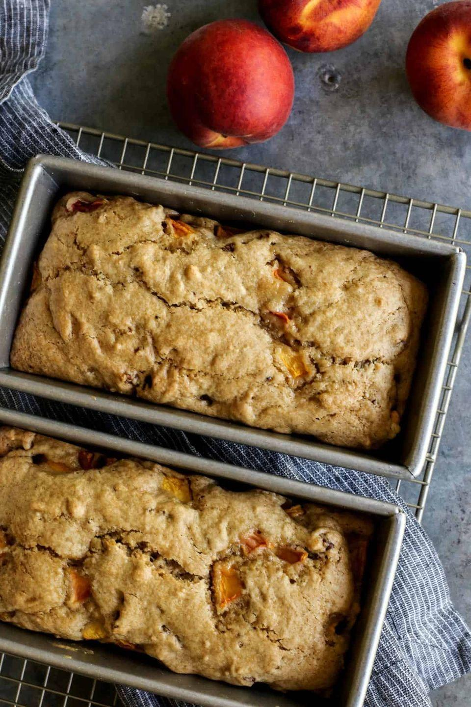"""<p>If you love a good quick bread, then you'll love this delicious peach bread. It's a great way to use over-ripe peaches. <br></p><p><strong>Get the recipe at <a href=""""https://www.afarmgirlsdabbles.com/peach-bread/"""" rel=""""nofollow noopener"""" target=""""_blank"""" data-ylk=""""slk:A Farmgirl's Dabbles"""" class=""""link rapid-noclick-resp"""">A Farmgirl's Dabbles</a>.</strong></p><p><a class=""""link rapid-noclick-resp"""" href=""""https://go.redirectingat.com?id=74968X1596630&url=https%3A%2F%2Fwww.walmart.com%2Fsearch%2F%3Fquery%3Dpioneer%2Bwoman%2Bbaking%2Bpan&sref=https%3A%2F%2Fwww.thepioneerwoman.com%2Ffood-cooking%2Frecipes%2Fg36382592%2Fpeach-desserts%2F"""" rel=""""nofollow noopener"""" target=""""_blank"""" data-ylk=""""slk:SHOP BAKING PANS"""">SHOP BAKING PANS</a></p>"""
