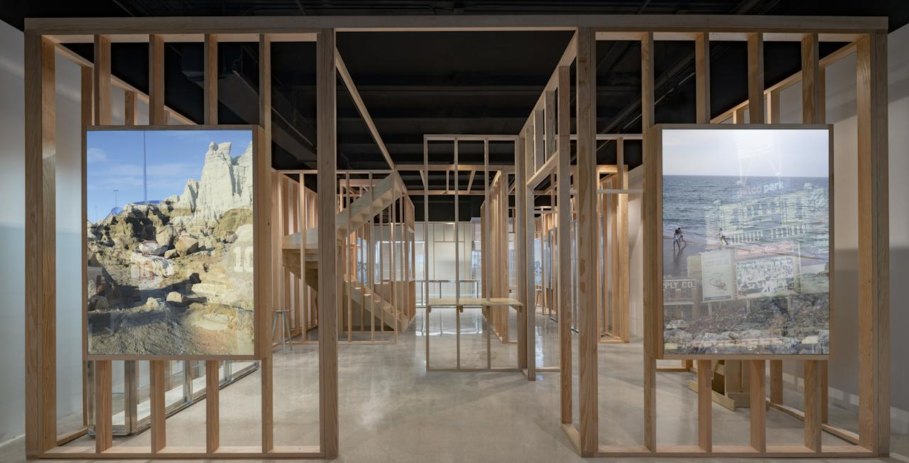 """""""I think that in the shell of a house, there are rooms that signify multiple facets and categories,"""" says Byredo founder Ben Gorham. In his new temporary location, in Miami's Design District, Gorham emphasizes these spatial breakdowns in the form of a shop that appears under construction. It was inspired, in part, by the founder's own personal renovation journey. """"Beyond the fact that I'm actually building a house that I spent two years designing, the idea of a halt in construction, of something unfinished, felt like a fitting illustration of what we do,"""" he tells AD PRO. Each of the in-process rooms feature large-scale photographic illustrations of places significant to Gorham (and photographed by him). """"I wanted to keep it intimate while making the store a journey within itself,"""" he says."""