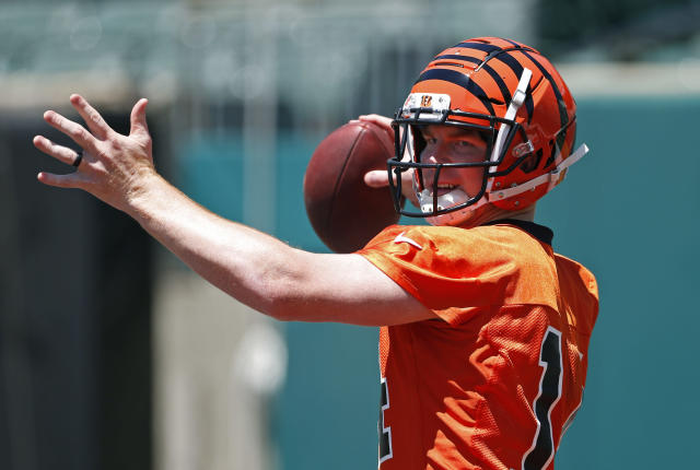 Cincinnati Bengals quarterback Andy Dalton throws during an NFL football practice Tuesday, June 11, 2019, in Cincinnati. (AP Photo/Gary Landers)