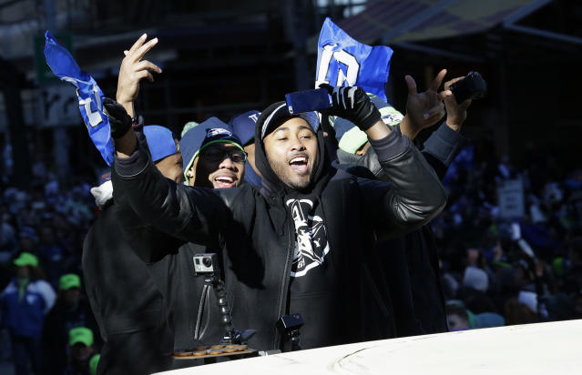 Seattle Seahawks linebacker and Super Bowl MVP Malcolm Smith gestures to fans during the Super Bowl champions parade, Wednesday, Feb. 5, 2014, in Seattle. The Seahawks defeated the Denver Broncos 43-8 in NFL football's Super Bowl XLVIII on Sunday. (AP Photo/Ted S. Warren)