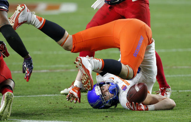 Boise State tight end Holden Huff is up-ended against Arizona during the second half of the Fiesta Bowl NCAA college football game, Wednesday, Dec. 31, 2014, in Glendale, Ariz. (AP Photo/Ross D. Franklin)