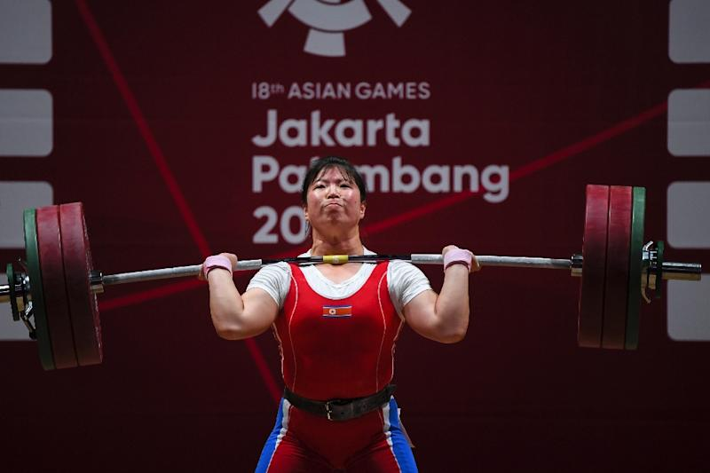 North Korea's Rim Jong Sim lifts during the clean and jerk women's 75kg weightlifting group A event during 2018 Asian Games in Jakarta on August 26, 2018