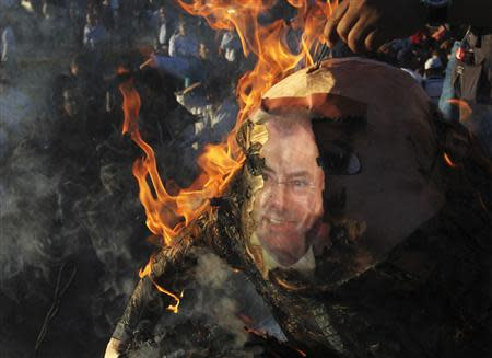 Demonstrators burn an effigy of Mexico's Finance Minister Luis Videgaray during a protest against the federal government's economic and tax reforms in Ciudad Juarez