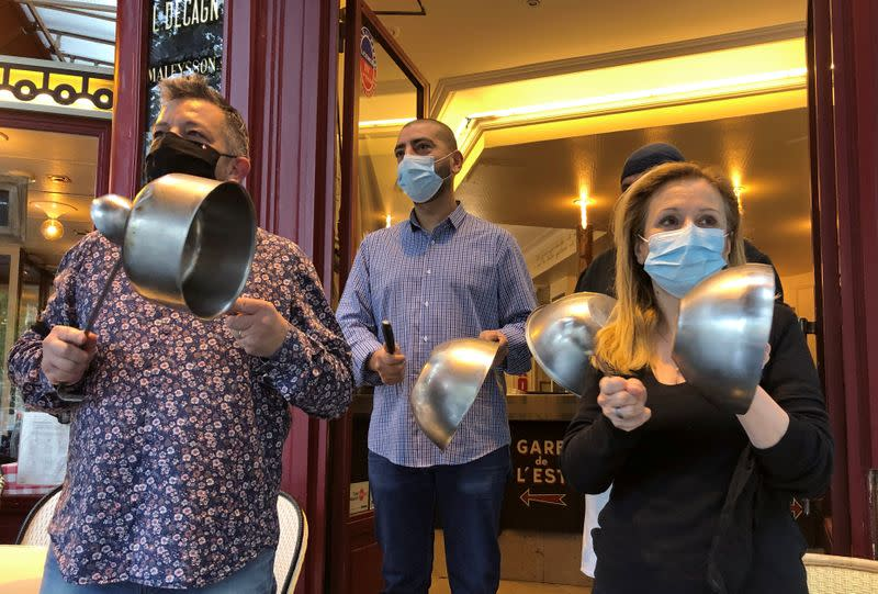 Restaurant owners protest in Paris over fears of COVID shutdown