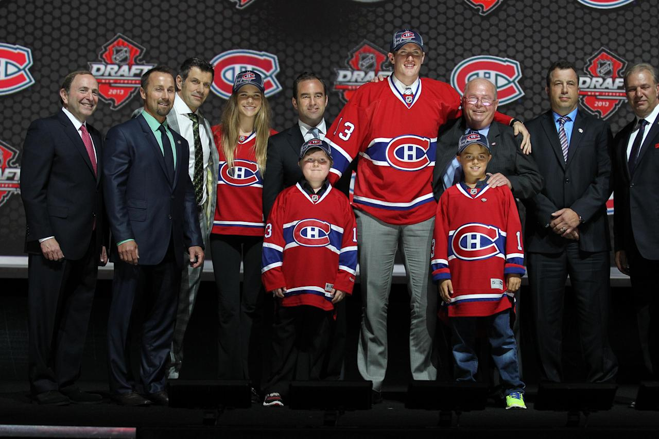 Jun 30, 2013; Newark, NJ, USA; Michael McCarron poses for a photo after being introduced as the number twenty-five overall pick to the Montreal Canadiens during the 2013 NHL Draft at the Prudential Center. (Ed Mulholland-USA TODAY Sports)