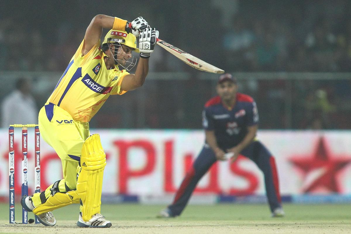 Suresh Raina of the Chennai Super Kings drives a delivery during match 24 of the Pepsi Indian Premier League between The Delhi Daredevils and the Chennai Superkings held at the Feroz Shah Kotla Stadium, Delhi on the 18th April 2013..Photo by Shaun Roy-IPL-SPORTZPICS  ..Use of this image is subject to the terms and conditions as outlined by the BCCI. These terms can be found by following this link:..https://ec.yimg.com/ec?url=http%3a%2f%2fwww.sportzpics.co.za%2fimage%2fI0000SoRagM2cIEc&t=1503047852&sig=UDKxPXwPwh1DsPR2lnZKtw--~D