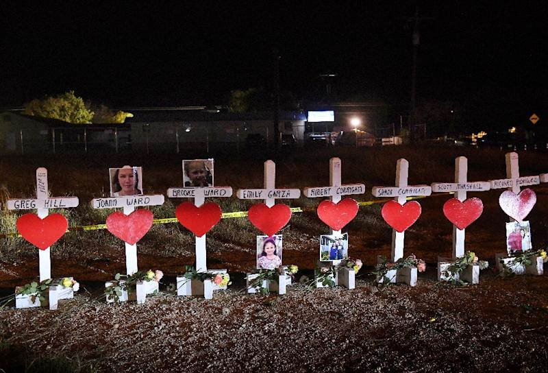 Crosses with the names of victims are seen outside the First Baptist Church in Sutherland Springs, Texas, where shooter Devin Kelley killed 26 people