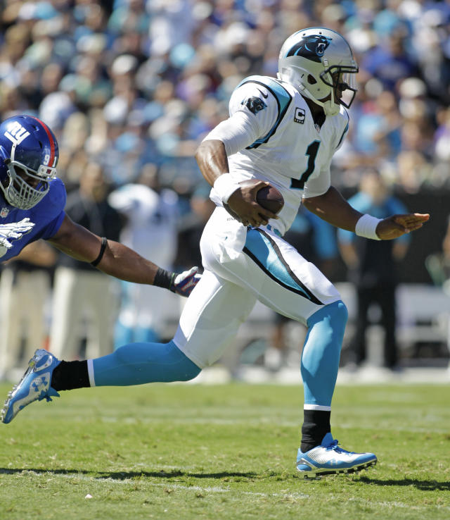 Carolina Panthers quarterback Cam Newton (1) scrambles past New York Giants defensive end Justin Tuck (91) during the first half of an NFL football game in Charlotte, N.C., Sunday, Sept. 22, 2013. (AP Photo/Bob Leverone)