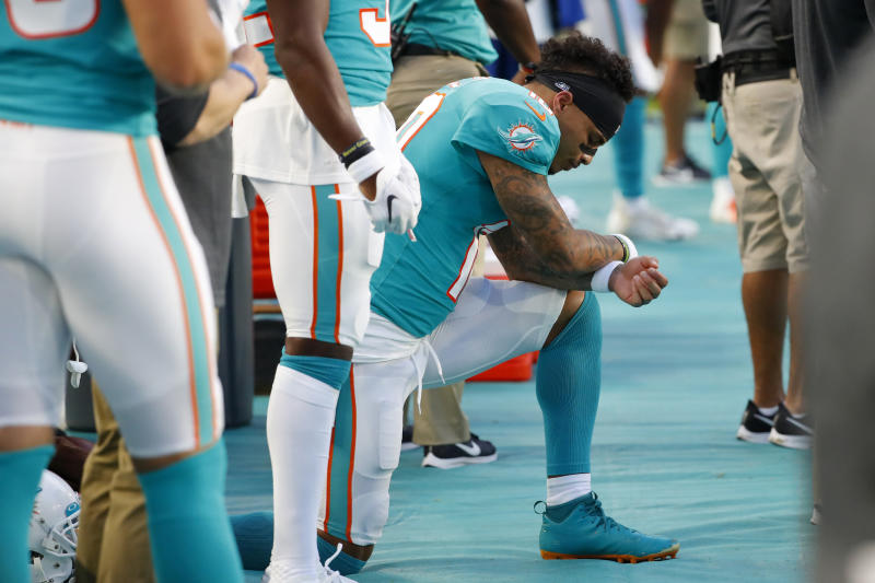 Miami Dolphins wide receiver Kenny Stills kneels during the national anthem before the team's preseason game against the Atlanta Falcons on Aug. 8. (AP)