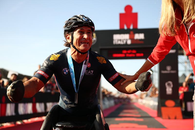 CERVIA, ITALY - SEPTEMBER 21: Alex Zanardi of Italy celebrates finishing IRONMAN Italy on September 21, 2019 in Cervia, Italy. (Photo by Bryn Lennon/Getty Images for IRONMAN)