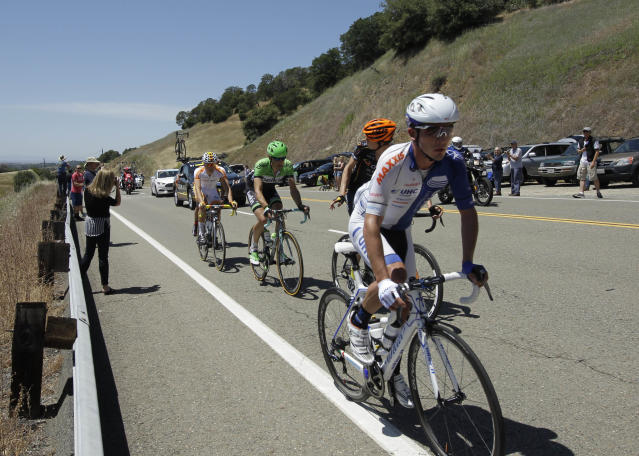 Isaac Bolivar Hernandez, of Colombia, right, who races for the United Health Care team, climbs Indian Hill Road with other leaders of Stage I of the Tour of California cycling race, climb Indian Hill Road after leaving Newcastle Calif., Sunday, May 11, 2014.(AP Photo/Rich Pedroncelli)