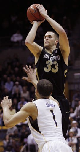 Colorado's Austin Dufault (33) shoots as California's Justin Cobbs defends during the first half of an NCAA college basketball game, Thursday, Jan. 12, 2012, in Berkeley, Calif. (AP Photo/George Nikitin)