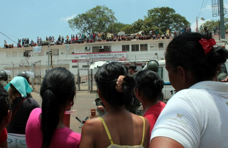 Inmates pictured at a 2013 protest at Venezuela's Sabaneta jail, where 121 prisoners were killed in a riot in 1994 (AFP/JIMMY PIRELA)