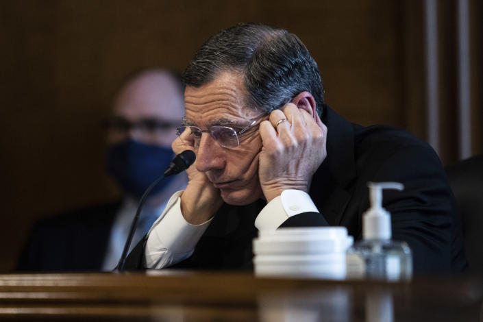 Senator John Barrasso, R-WY, listens to Rep. Deb Haaland, D-N.M., during a confirmation hearing before the Senate Committee on Energy and Natural Resources hearing on her nomination to be Interior Secretary, Tuesday, Feb. 23, 2021 on Capitol Hill in Washington. (Graeme Jennings/Pool via AP)