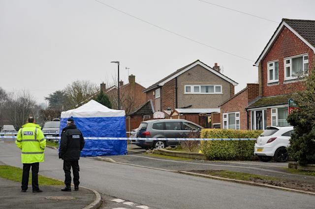 Police at the scene in Duffield, Derbyshire after two people were found dead in a house. (PA Images)