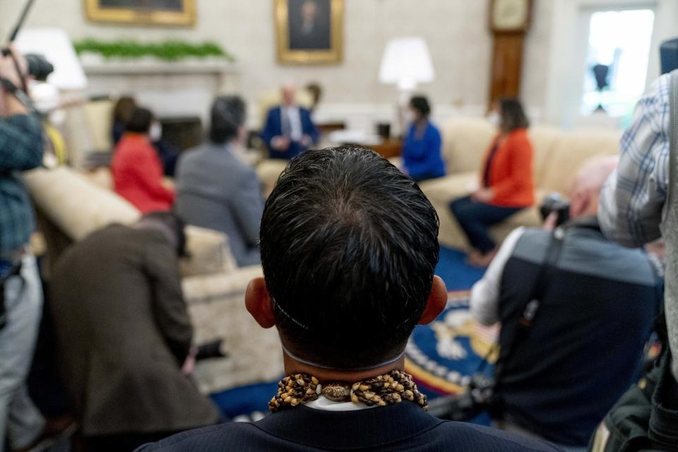 Rep. Kaiali'i Kahele, D-Hawaii, attends a meeting with President Joe Biden and other members of the Congressional Asian Pacific American Caucus Executive Committee in the Oval Office at the White House in Washington, Thursday, April 15, 2021. (AP Photo/Andrew Harnik)