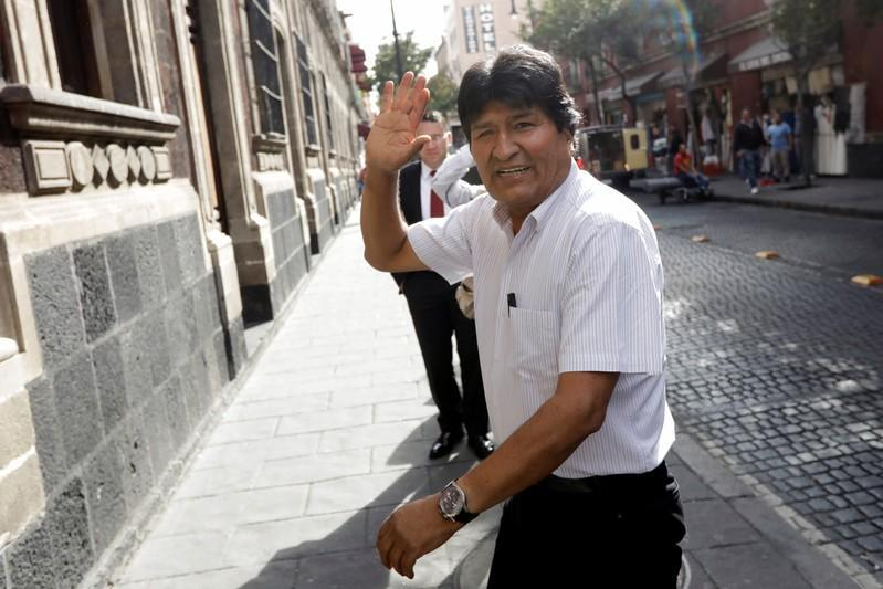 Bolivia's ousted president Evo Morales waves as he arrives to deliver a news conference in downtown Mexico City