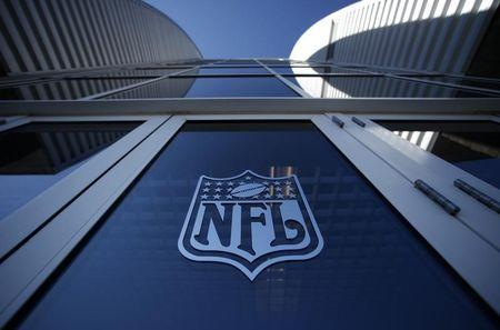NFL logo appears on an entrance door to football stadium at Super Bowl XLII in Glendale