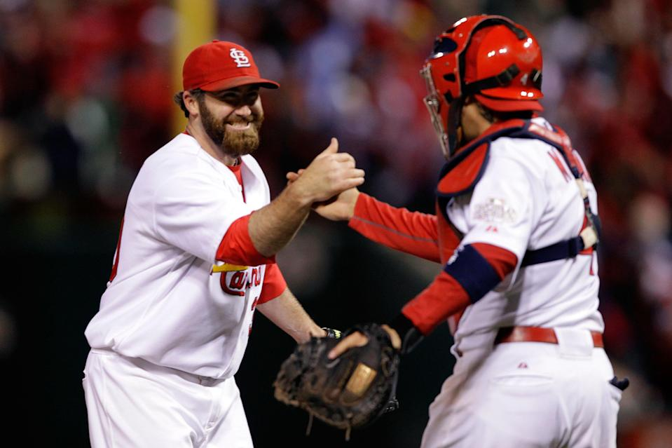 ST LOUIS, MO - OCTOBER 19: Jason Motte #30 and Yadier Molina #4 of the St. Louis Cardinals celebrate after defeating the Texas Rangers 3-2 during Game One of the MLB World Series at Busch Stadium on October 19, 2011 in St Louis, Missouri. (Photo by Rob Carr/Getty Images)