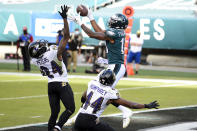 Philadelphia Eagles' Travis Fulgham (13) catches a touchdown pass against Baltimore Ravens' Marlon Humphrey (44) and Marcus Peters (24) during the second half of an NFL football game, Sunday, Oct. 18, 2020, in Philadelphia. (AP Photo/Derik Hamilton)
