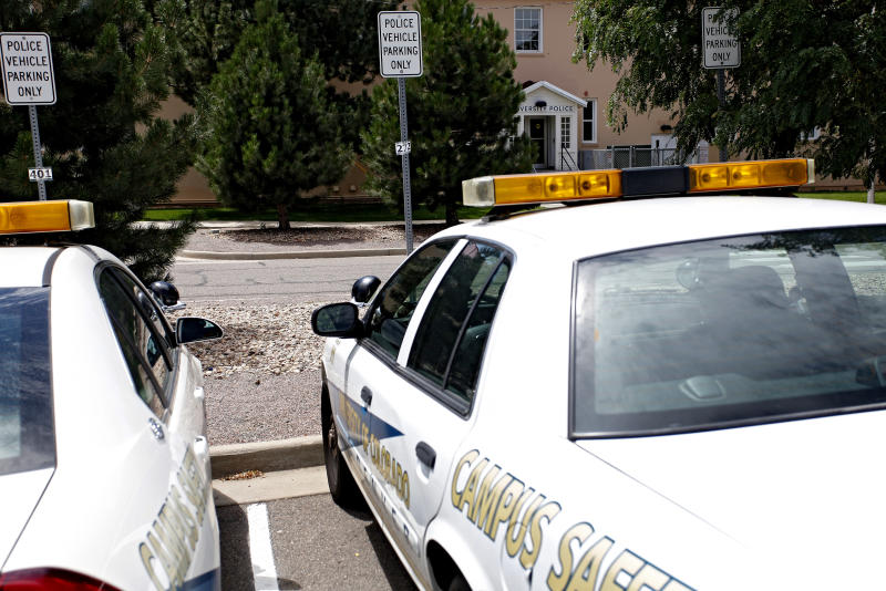 University of Colorado Police patrol car are parked in front of the police headquarters at the University of Colorado Medical Campus in Aurora, Colo.,on Thursday, August 2, 2012. Suspected movie theater shooter James Holmes was studying neuroscience at the medical school and a psychiatrist there raised an alarm about his behavior. In the wake of a student's deadly attack at Virginia Tech five years ago, schools across the country put into place teams meant to bring together faculty and staff to notice _ and take action _ when a student appears to be a threat. The school won't say if campus police ever were alerted to Holmes, or whether faculty or staff ivestigated his behavior.(AP Photo/Ed Andrieski)