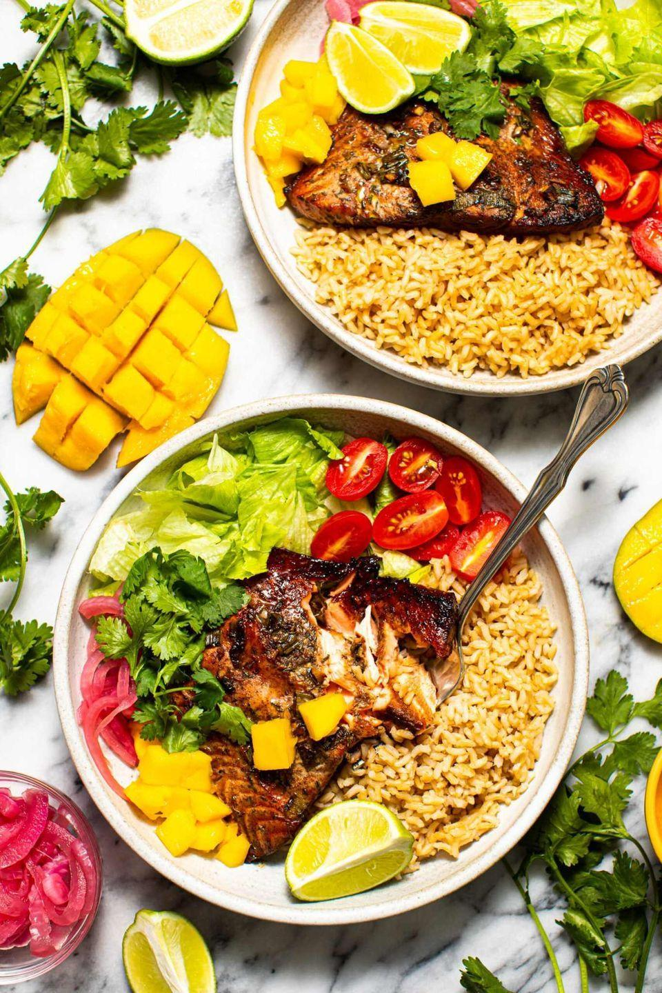 """<p>The homemade jerk marinade in this recipe takes baked salmon to a whole other level of flavor. Marinate the fish overnight for best results, and customize the bowls with your favorite toppings.</p><p><strong>Get the recipe at <a href=""""https://www.butterbeready.com/jerk-salmon-bowls/"""" rel=""""nofollow noopener"""" target=""""_blank"""" data-ylk=""""slk:Butter Be Ready"""" class=""""link rapid-noclick-resp"""">Butter Be Ready</a>.</strong> </p>"""