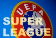 Super League words are seen in front of the UEFA logo in this illustration