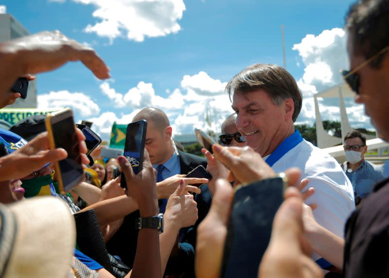 FILE PHOTO: Brazil's President Bolsonaro meets supporters during a protest against Brazil's Congress and Brazilian Supreme Court, in front of the Planalto Palace in Brasilia