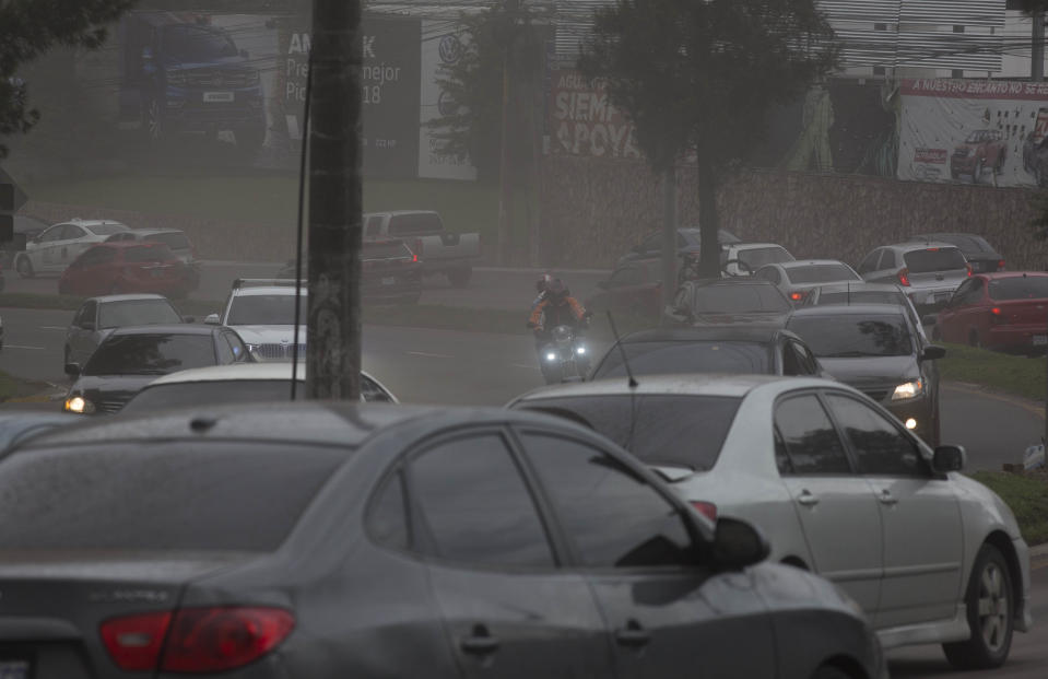 <p> Drivers make their way through a light rain of volcanic ash, as the Volcan de Fuego erupts, in Guatemala City, Sunday, June 3, 2018. Volcan del Fuego is one of the most active volcanoes in Central America. (AP Photo/Luis Soto) </p>