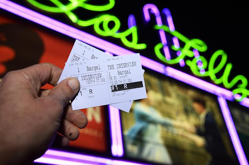 """Two tickets for the movie """"The Interview"""" are seen in front of the Los Feliz 3 Cinema in Los Angeles, California on December 23, 2014 (AFP Photo/Robyn Beck)"""