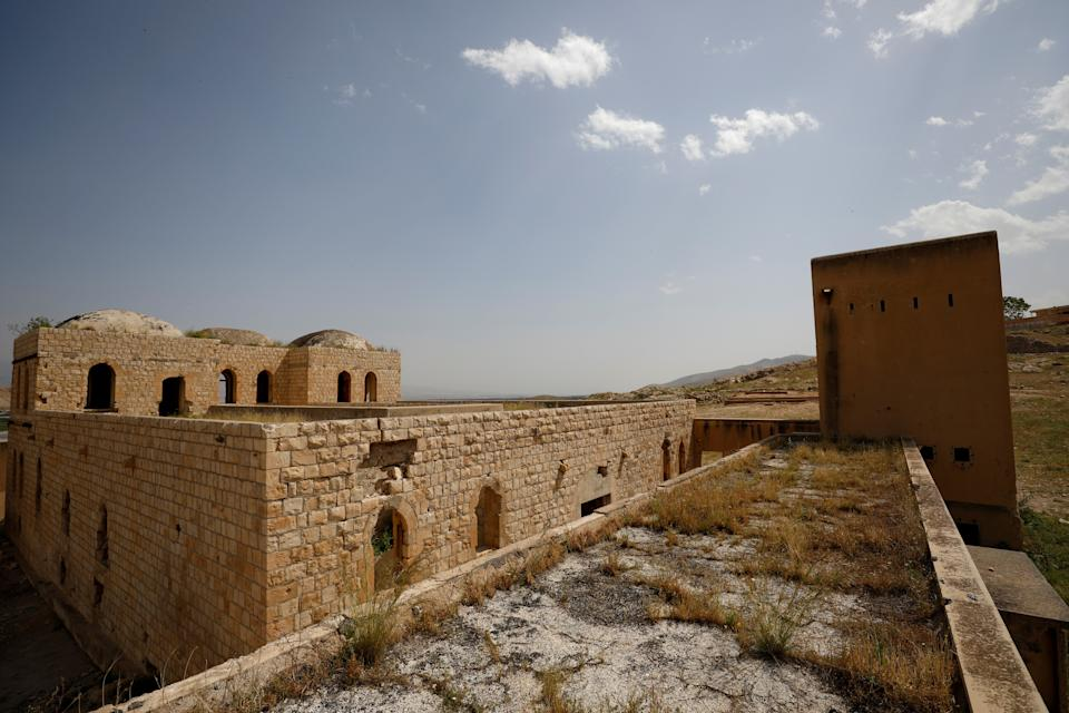 Buildings constructed during the British Mandate era to serve as jails and fortified positions are seen in Al-Jiftlik village near Jericho, in the Israeli-occupied West Bank, April 7, 2019. Long abandoned, sheep now wander through the empty buildings, searching for vegetation in the scorching heat of the Jordan Valley. The Israeli military sometimes uses them for training, Palestinian residents say. (Photo: Ronen Zvulun/Reuters)