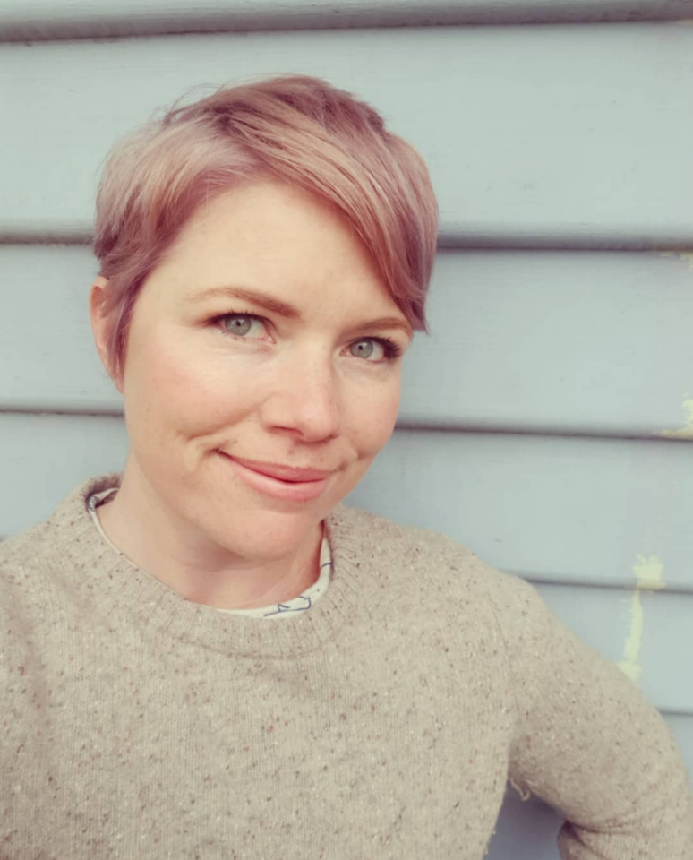 A photo of Clementine Ford wearing a cream jumper.