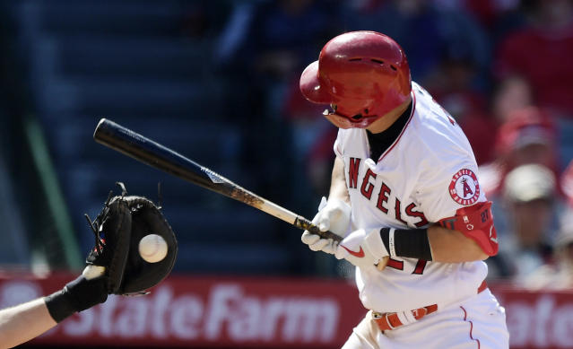 Los Angeles Angels' Mike Trout, right, winces as he is hit by a pitch while Kansas City Royals catcher Cam Gallagher catches during the seventh inning of a baseball game Sunday, May 19, 2019, in Anaheim, Calif. (AP Photo/Mark J. Terrill)