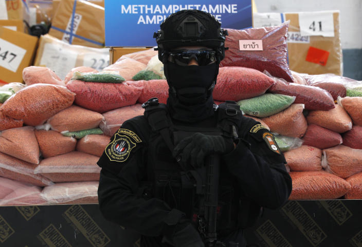 AYUTTHAYA, THAILAND - 2019/06/26: A police officer from the Narcotics Control Board stands on guard in front of bags of methamphetamine pills during the 49th Destruction of Confiscated Narcotics ceremony to mark the International Day Against Drug Abuse and Illicit Trafficking in Ayutthaya province, north of Bangkok. More than 16,467 Kg of drugs, including methamphetamine, marijuana, heroin and opium, worth more than $600 million, were destroyed as the Thai government began its anti-drug campaign, according to the Thai Ministry of Public Health. (Photo by Chaiwat Subprasom/SOPA Images/LightRocket via Getty Images)