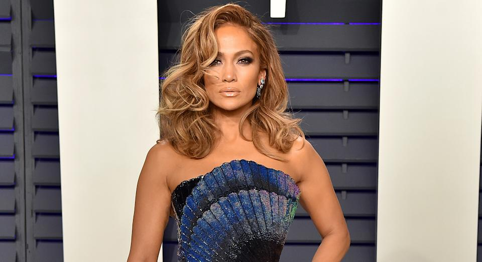 Just over one year after Jennifer Lopez attended the Vanity Fair Oscar she has released a new track and music video Pa Ti + Lonely, and her make-up artist has revealed the secret behind her glow. (Getty Images)