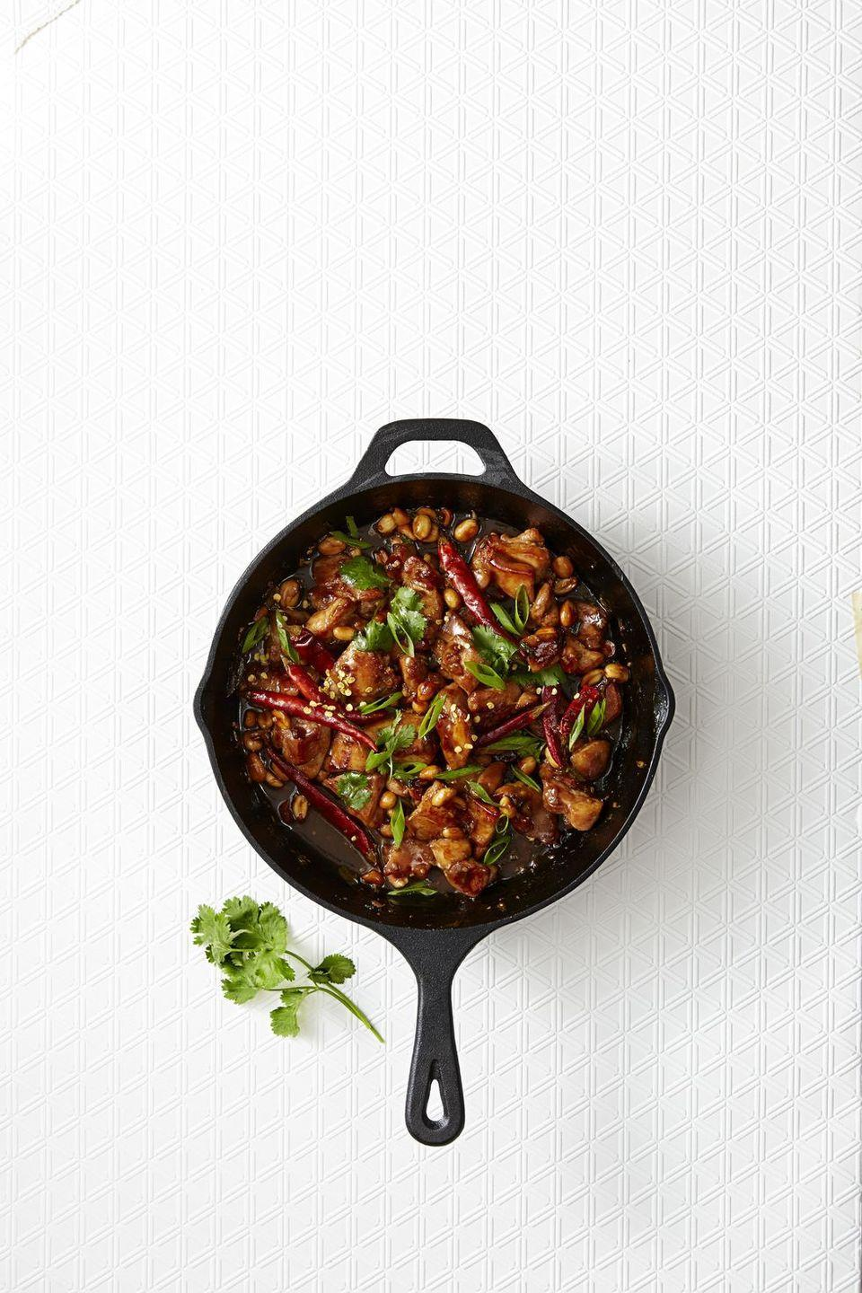 "<p>Calling all spice lovers: This classic Sichuan meal features chicken, peanuts and whole dried chiles.</p><p><em><a href=""https://www.goodhousekeeping.com/food-products/a42818/fiery-kung-pao-chicken-recipe/"" rel=""nofollow noopener"" target=""_blank"" data-ylk=""slk:Get the recipe from Fiery Kung Pao Chicken »"" class=""link rapid-noclick-resp"">Get the recipe from Fiery Kung Pao Chicken »</a></em></p>"