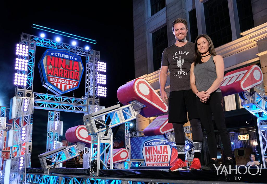 <p>Each celebrity is paired with an experienced Ninja, who serves as their coach and cheerleader. Amell is partnered with Kacy Catanzaro<i>, </i>who became the first woman to earn a spot in the <em>American Ninja Warrior</em> finals in 2014.<br /><br />(Photo: Tyler Golden/NBC) </p>