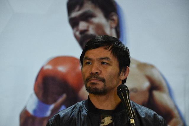 Manny Pacquiao's (pictured January 2019) Twitter poll drew 27,380 votes after five hours and listed Floyd Mayweather, Keith Thurman, Danny Garcia and Shawn Porter as the choices (AFP Photo/TED ALJIBE)