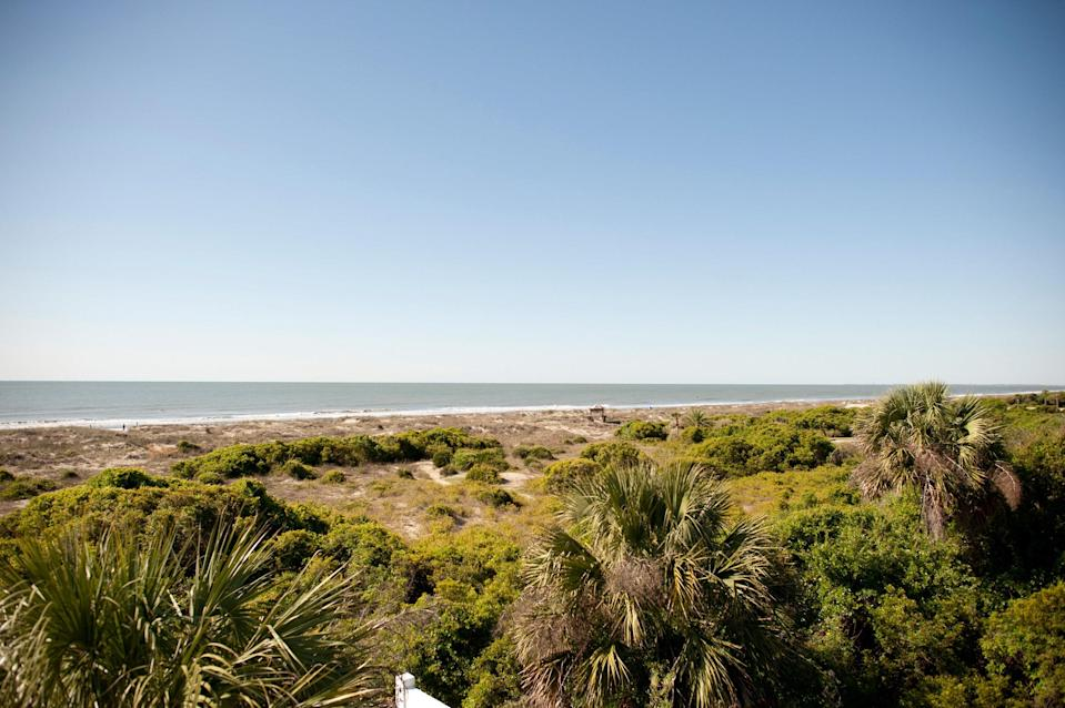 <p><strong>Give us the wide-angle view: what kind of beach are we talking about?</strong><br> Isle of Palms, one of the area's most family-friendly beaches, stretches across seven miles of shoreline. Between the two ends is a tight seaside community that offers a vast range of activities (water sports, golfing, boat tours, and fishing charters), plus stunning white sands.</p> <p><strong>How accessible is it?</strong><br> It's just a 12-mile drive through Mount Pleasant to reach IOP County Park (as the locals call it). Parking is easiest in the Municipal Parking Lots. Parking tickets are available for purchase at the automated parking kiosks inside the parking lot. The daily rate is $12 Monday through Friday and $15 Saturday, Sunday and holidays. After 4 p.m., visitors may pay an hourly rate of $2.50. Once there, the shoreline is eminently walkable, though if you want to scope out the entire stretch, you might want to rent a bicycle.</p> <p><strong>Decent services and facilities, would you say?</strong><br> The main County Park lot has a vending area and bathrooms, so you can both change and buy sunhats, boogie boards, and beach sundries as well as basic snacks. There's also a rental station for chairs and umbrellas.</p> <p><strong>How's the actual beach stuff—sand and surf?</strong><br> The sands are family-friendly—they're nice and soft, and you'll see plenty of other kids splashing around. Beyond the opportunities for swimming and surfing, the Wild Dunes public golf courses are a big draw, along with the sports fishing charters and the ever-popular sunset dolphin-watching cruises.</p> <p><strong>Can we go barefoot?</strong><br> It's smooth, white sands as far as you can see, with plenty of space to lay out even during peak season.</p> <p><strong>Anything special we should look for?</strong><br> If you can, arrange a way to get out on the water, whether it's to fish, or take an eco tour of the barrier islands (IOP attracts turtles during egg laying season). If you'