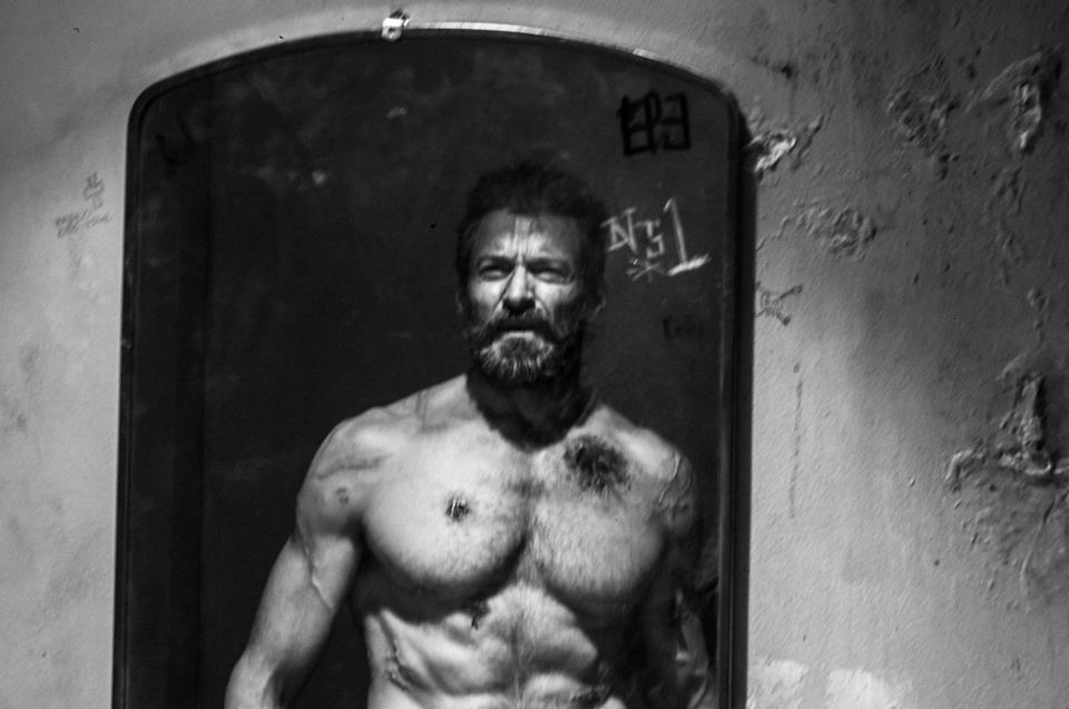 """<p>In 'Logan,' Hugh Jackman's Wolverine has become a weathered desert desperado with a diminished healing factor, but despite his beaten-and-bruised body, director James Mangold's mirror-image photo of the mutant — boasting his usual chiseled muscles — proves the actor's gym-rat preparation for the role hasn't changed. (Photo: <a rel=""""nofollow noopener"""" href=""""https://twitter.com/mang0ld?ref_src=twsrc%5Etfw"""" target=""""_blank"""" data-ylk=""""slk:@mang0ld"""" class=""""link rapid-noclick-resp"""">@mang0ld</a>/Twitter) </p>"""
