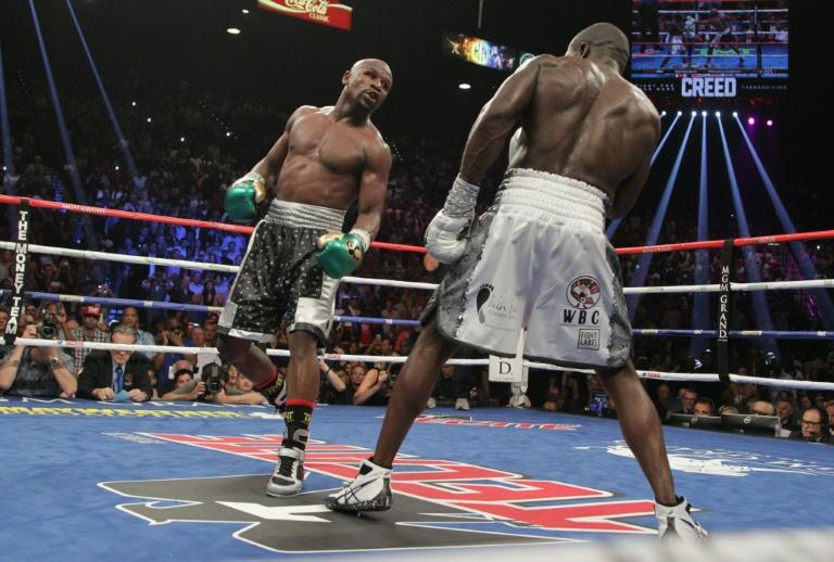 Floyd Mayweather (L) dances around Andre Berto during their WBO Welterweight World Title at the MGM Grand Garden Arena in Las Vegas, Nevada on September 12, 2015