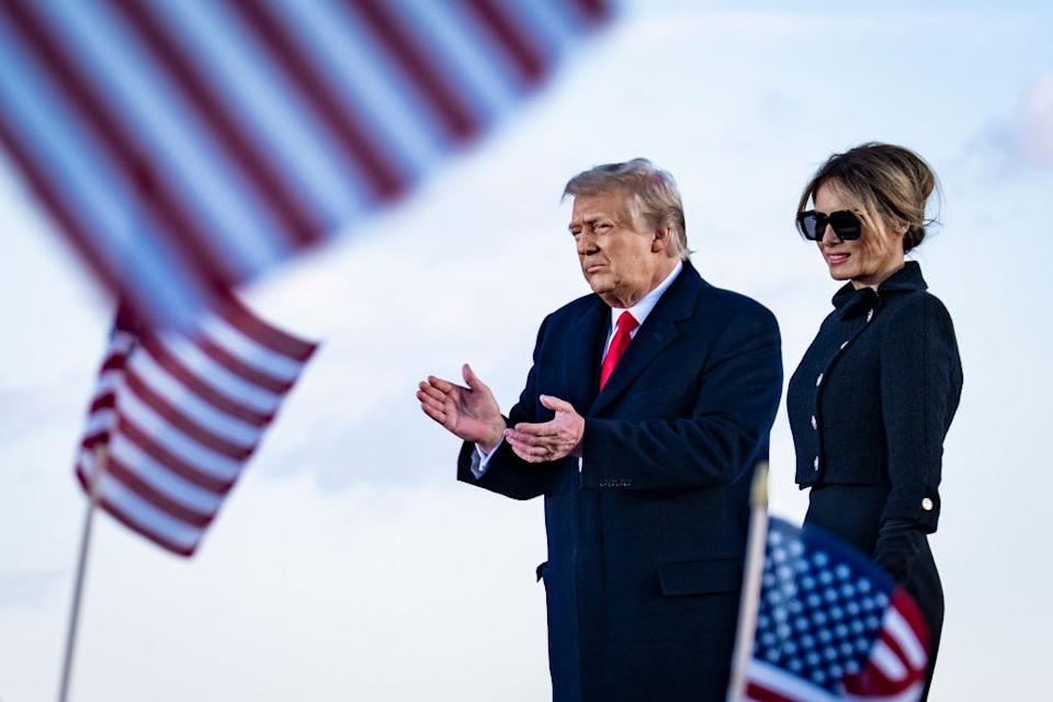 President Donald Trump and First Lady Melania Trump on stage after speaking to supporters at Joint Base Andrews before boarding Air Force One.