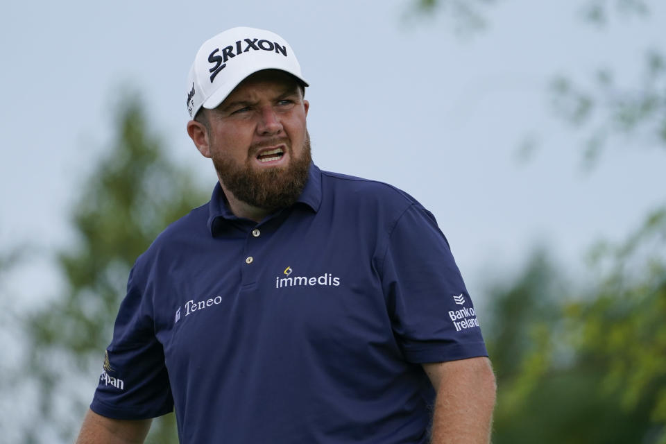 Shane Lowry, of Ireland, watches his shot off the fourth tee in the second round at the Northern Trust golf tournament, Friday, Aug. 20, 2021, at Liberty National Golf Course in Jersey City, N.J. (AP Photo/John Minchillo)