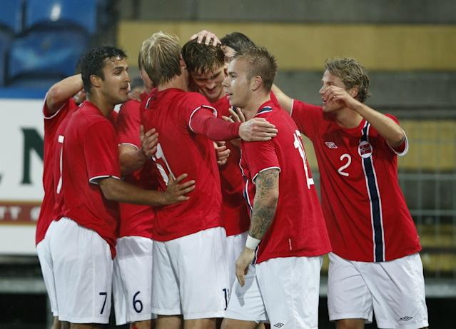 Norway's defender Thomas Rogne (C) celebrates with his teammates after he scored Norway's third goal during the UEFA European Under 21 Championship Qualifying Play-Off soccer match between Norway and France at Marienlyst Stadium in Drammen, Norway, on October, 16, 2012. AFP PHOTO / SCANPIX / ERLEND AAS NORWAY OUTERLEND AAS/AFP/Getty Images