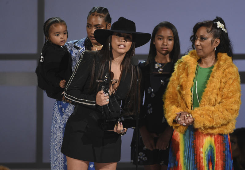 Lauren London accepts the humanitarian award on behalf of late rapper Nipsey Hussle at the BET Awards on Sunday, June 23, 2019, at the Microsoft Theater in Los Angeles. Pictured from left are Hussle's family, son Kross, sister Samantha Smith, daughter Emani Asghedom and mother Angelique Smith. (Photo by Chris Pizzello/Invision/AP)