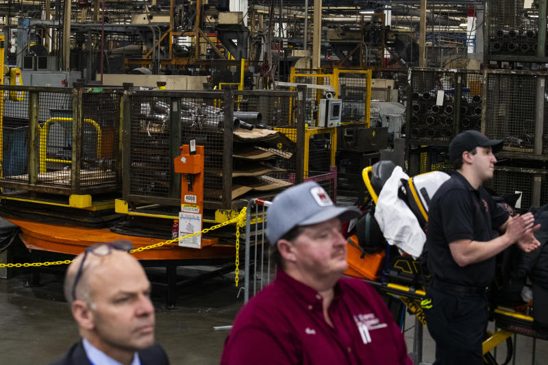 WARREN, MI - JANUARY 30: Employees and guests look on as President Donald Trump speaks at Dana Incorporated, an auto-manufacturing supplier, on January 30, 2020 in Warren, Michigan. During his speech Trump touted good job numbers and the strong performance of car companies in the state. (Photo by Brittany Greeson/Getty Images)