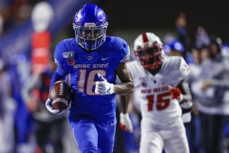 Boise State wide receiver John Hightower (16) runs away from the New Mexico defense for a 51-yard touchdown reception during the first half of an NCAA college football game Saturday, Nov. 16, 2019, in Boise, Idaho. (AP Photo/Steve Conner)