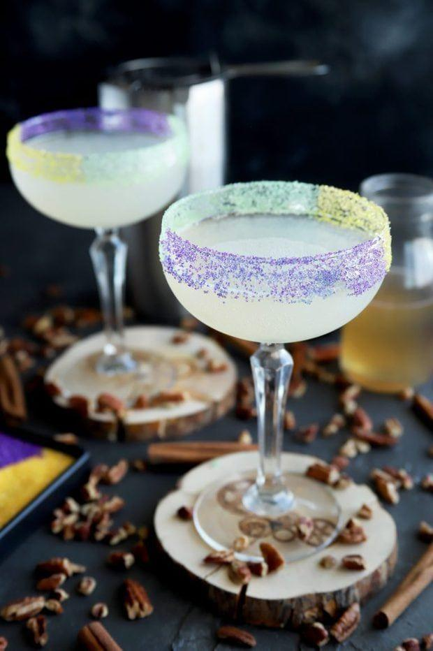 """<p>Get a taste of the celebratory Carnival confection, with this king cake-inspired daiquiri. The refreshing cocktail replicates nearly ever aspect of the decadent dessert—from the hint of cinnamon and vanilla to the gold, green, and purple sprinkles—with one exception: You won't find a plastic baby hidden inside.</p><p><a class=""""link rapid-noclick-resp"""" href=""""https://www.cakenknife.com/king-cake-daiquiri/"""" rel=""""nofollow noopener"""" target=""""_blank"""" data-ylk=""""slk:GET THE RECIPE"""">GET THE RECIPE</a></p>"""