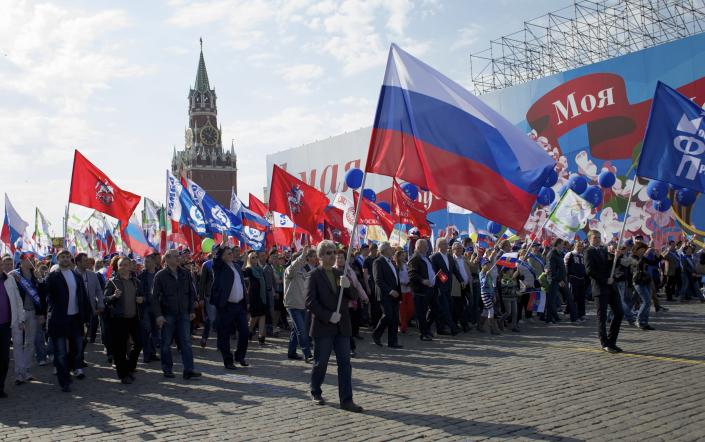 Members of Russian Trade Unions march during the May Day celebration in Red Square, Moscow, Russia, on Thursday, May 1, 2014. About 100,000 people have marched through Red Square to celebrate May Day, the first time the annual parade has been held on the vast cobblestoned square outside the Kremlin since the fall of the Soviet Union in 1991. (AP Photo/Ivan Sekretarev)