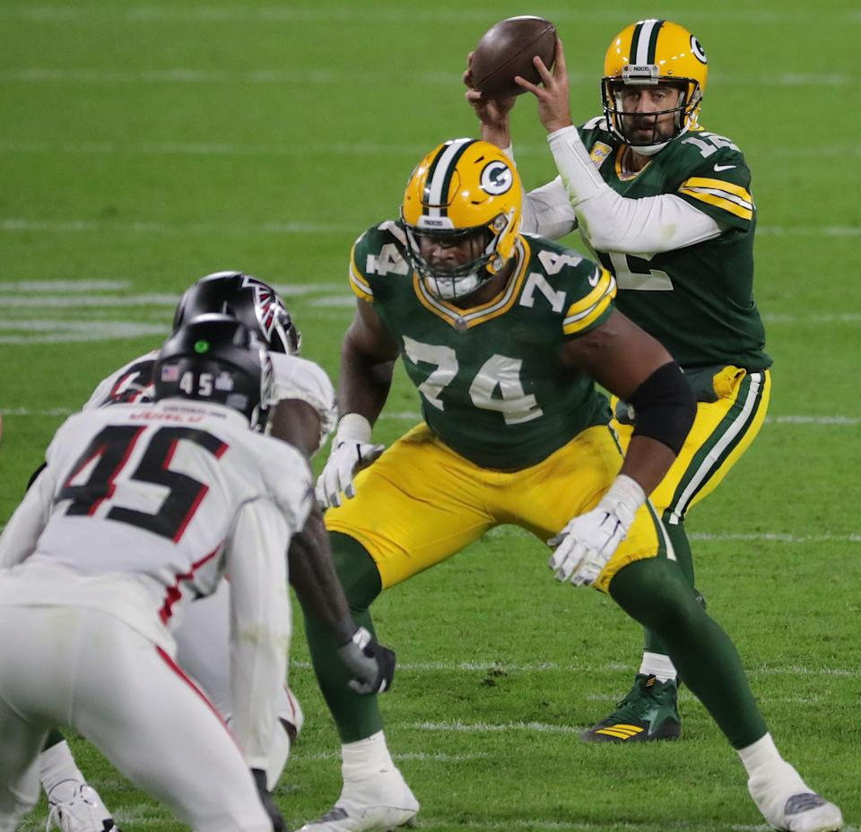 Elgton Jenkins (74) provides pass protection for quarterback Aaron Rodgers in a 30-16 win over the Falcons on Oct. 5, 2020.